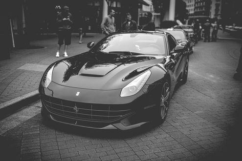 Обои Ferrari F12 Berlinetta / Феррари Ф12 Берлинетта черного цвета