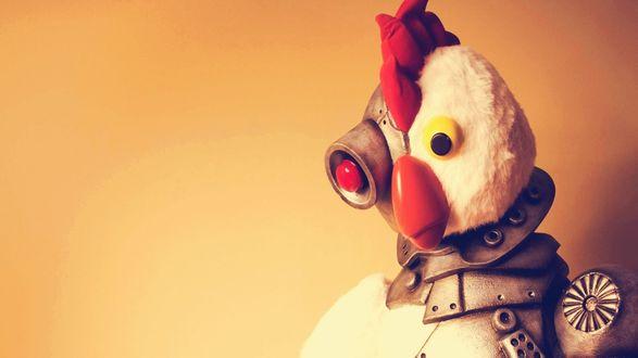 Обои Робоцып, герой из пародийного американского мультсериала Robot Chicken на оранжевом фоне