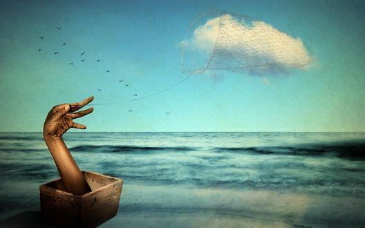 Обои Рука держит в сетях облако над морем