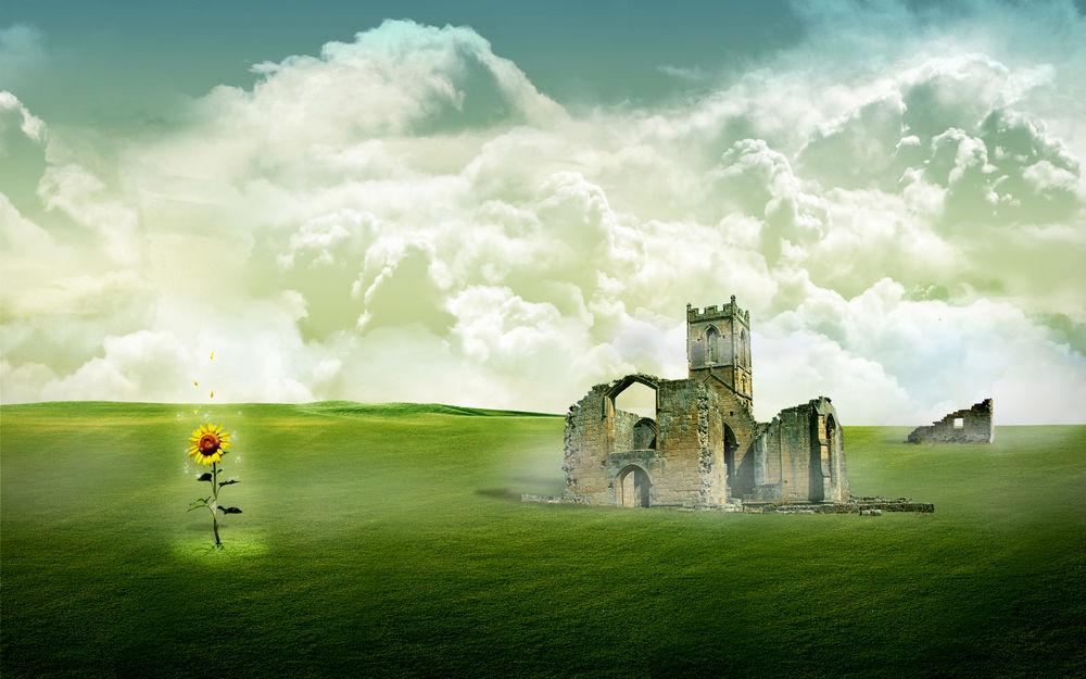 Обои для рабочего стола Подсолнух в зеленом поле рядом с разрушенным замком на фоне белых облаков