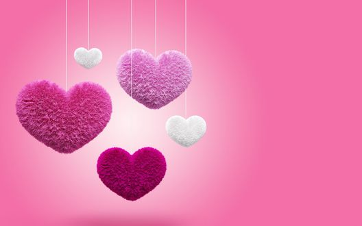 Обои Сердечки разных размеров и разных цветов висят на белых нитях, на розовом фоне