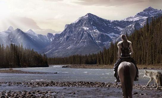 Обои Девушка на лошади и рядом собака на фоне горной реки и гор