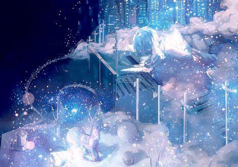 Обои Парень-ангел читает книгу, лежа среди облаков под падающим снегом