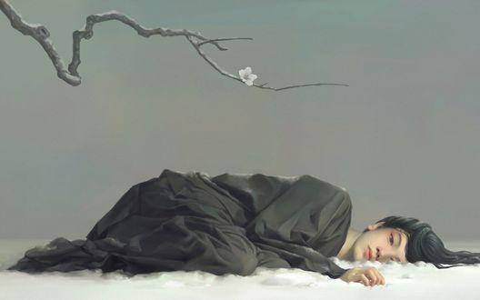 Обои Азиатка лежит на снегу