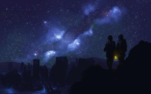 Обои Парень и девушка с зажженным фонарем, стоящие на скале смотрят на развалины города на фоне ночного, звездного неба и Млечного пути