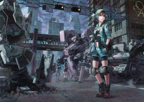 Обои Девушка в военной форме стоит возле танков и зданий и держит оружие в руке
