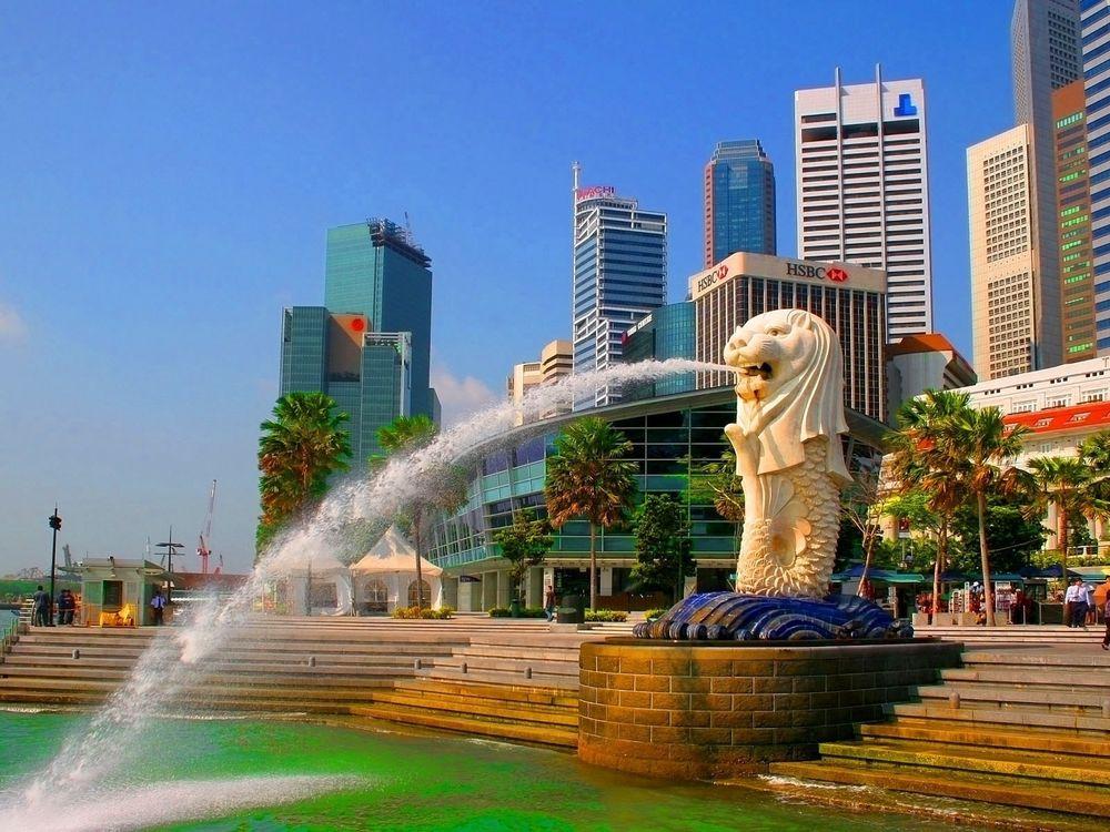 Обои для рабочего стола Фонтан в форме льва, выплевывающего воду, в Сингапуре / Singapore