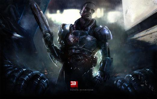 Обои Протагонист игры Mass Effect с оружием в руке