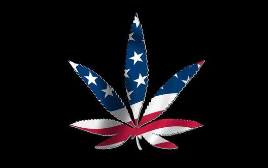 Обои Лист марихуаны (применяемой в медицине) на черном фоне, раскрашенный в цвета национального флага США
