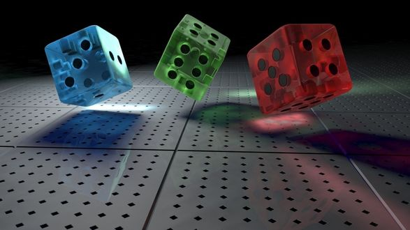 Обои Брошенные на металлический стол, разноцветные игральные кубики, в количестве трех штук