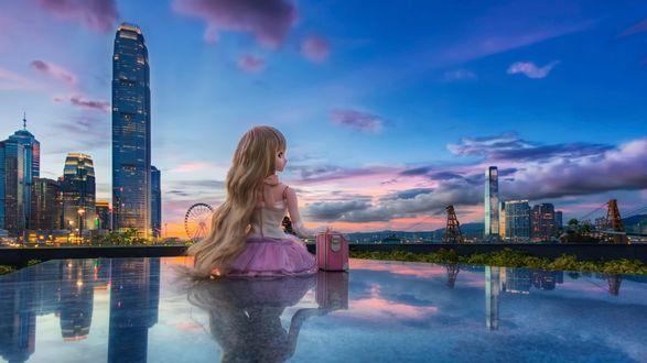 Обои Девушка-кукла смотрит на вечерний город