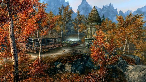 Обои Деревушка в окружении гор и осеннего леса