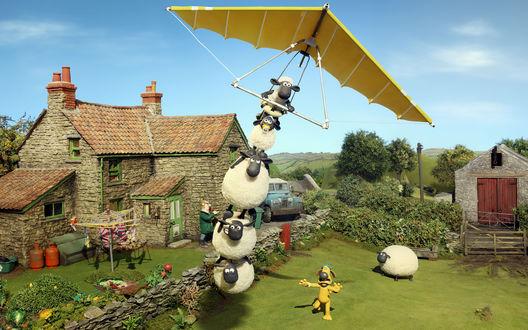 Обои Пес Битцер бежит по лужайке за барашком Шоном и овцами, летящими на дельтаплане, из мультфильма Shaun the Sheep / Барашек Шон