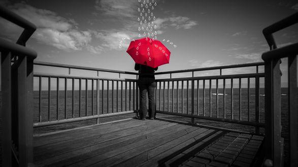 Обои Мужчина стоит на набережной с красным зонтиком, на который капают нарисованные капли и смотрит на воду