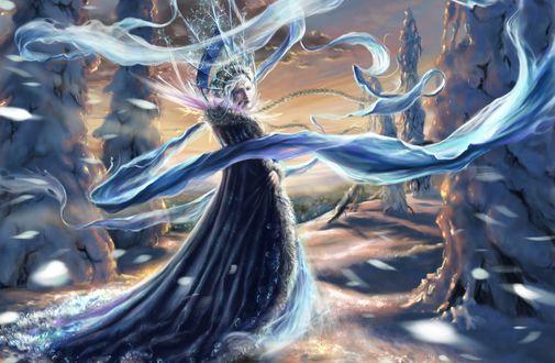 Обои Девушка Снегурочка из одноименной сказки стоит в заснеженном лесу, поднимая снежную бурю