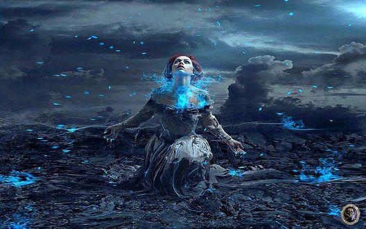 Обои Девушка в длинном черном платье стоит на одном колене расставив в сторону руки и подняв к небу голову, подставляя лицо и руки под голубые светящиеся капли