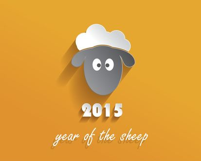 Обои Лицо овечки на фоне слов 2015 year of the sheep / 2015 год овцы