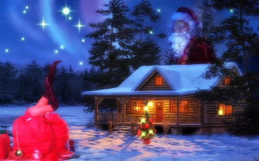 Обои Зима, домик в лесу, у домика елочка и подарок, за домиком бродит Дед Мороз