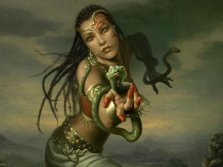 Обои У девушки с рисунками на лице по руках ползут зеленые змеи