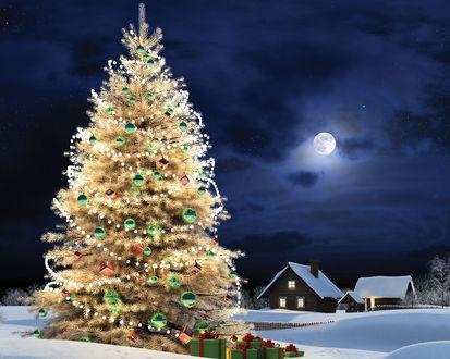 Обои Новогодняя елка с украшениями, под которой сложены подарки стоит на снегу, вдалеке виднеются дома с освещенными окнами, на небе светит полная Луна