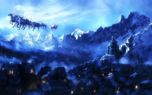 Обои Ночной город в окружении гор, по небу мчится Дед Мороз на оленях