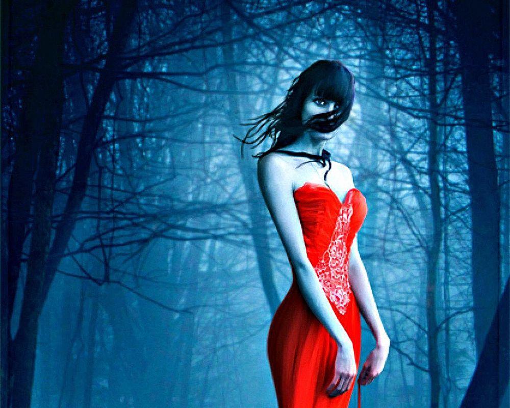 Обои для рабочего стола Девушка с закрытой черными волосами частью лица, в длинном красном платье, стоит на фоне синего леса