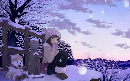 Обои Девочка сидит у изгороди на снегу