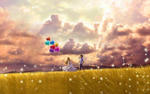 Обои В поле, на фоне облачного неба с просветом солнца парень и девушка, в руках которой разноцветные шары сердечки