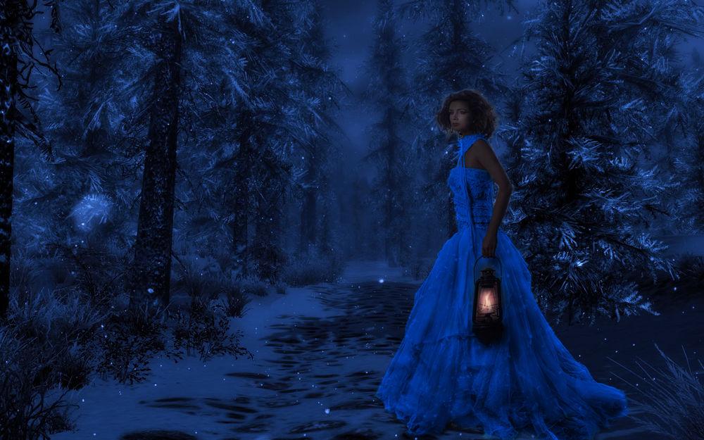Обои для рабочего стола Девушка на фоне зимнего леса с фонарем в руке
