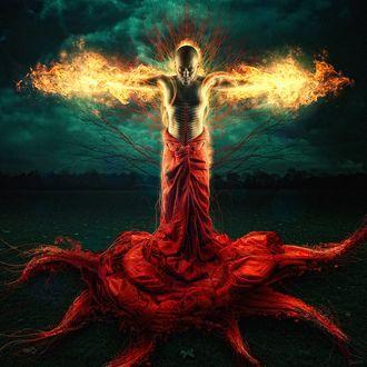 Обои Мужчина с завернутой в нижней части тела красной тканью стоит в красном цветке, с объятыми пламенем руками и головой, фотограф Roderique Arisiaman (Dracorubio)