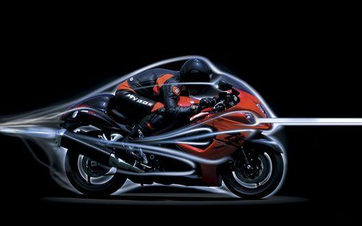 Обои Гонщик мчится на мотоцикле Suzuki GSX 1300 в неоновой подсветке