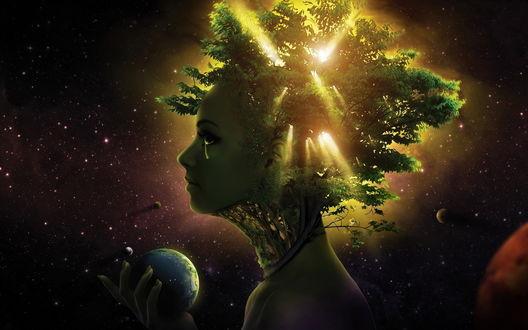 Обои Девушка-вселенная с волосами-деревьями, через которые пробиваются лучи солнца, держит в руке планету