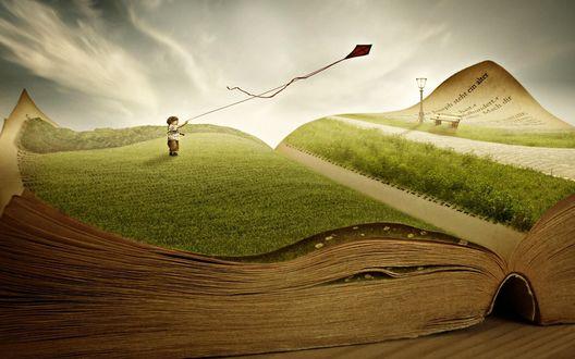 Обои На страницах раскрытой книги, мальчик на зеленом лугу запускает воздушного змея