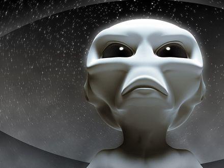 Обои Гуманоид подняв голову, смотрит в сторону родной планеты