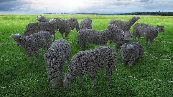 Обои Отара игрушечных овец с телефонными аппаратами вместо голов, пасется на зеленом лугу