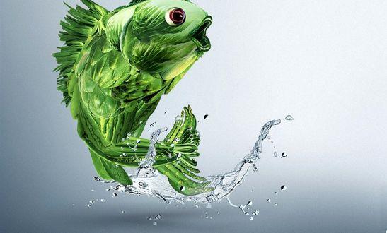 Обои Зеленая рыба подняла хвостом кучу брызг