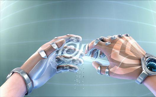Обои Руки в фантастических перчатках производят действие с неизвестным предметом