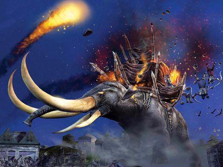Обои Гигантского боевого слона обстреливают с катапульт камнями и огненными шарами, боевая корзина горит и оттуда падают вооруженные люди