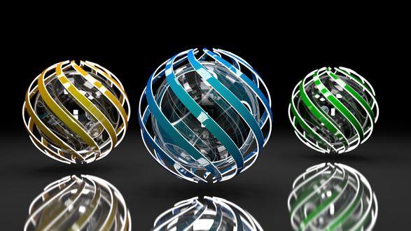Обои Три абстрактных шара в виде желтых, синих, зеленых плетеных лент, на блестящей поверхности