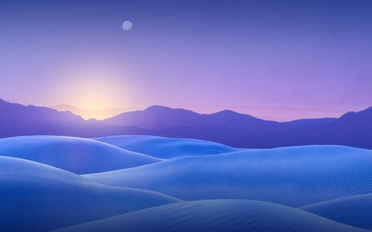 Обои Нежный свет заката над голубыми заснеженными возвышенностями