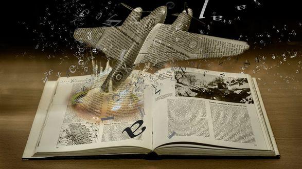 Обои Бумажный самолет, вылетающий из книги, с разлетающимися в стороны буквами