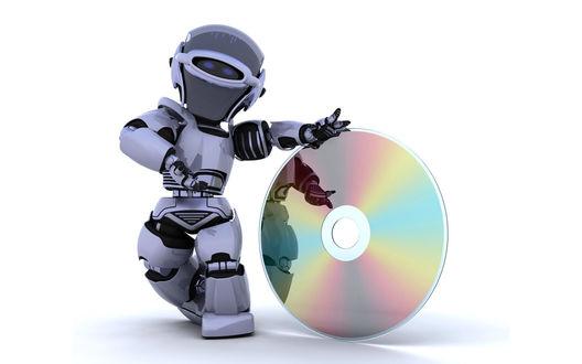Обои Робот стоит с диском CD