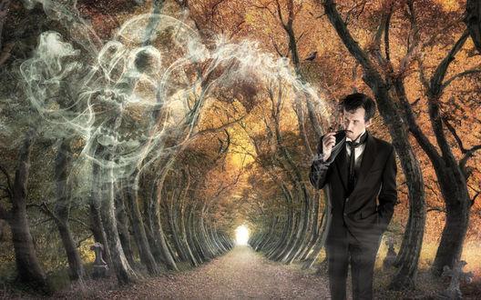 Обои Мужчина стоя на аллее курит люльку, дым поднимаясь вверх преобретает контуры человеческого черепа, между деревьями видны каменные кресты могил
