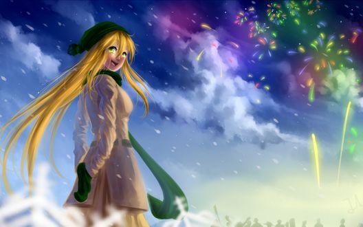 Обои Улыбающаяся девушка в шарфике, рукавичках и шапочке стоит под падающим снегом, на фоне неба, облаков и фейрверка