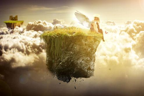Обои Девушка ангел сидит на парящей в небе среди облаков скале