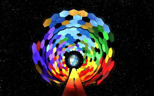 Обои Человек идет в отверстие из разноцветных шестиугольников в центре которого планета Земля