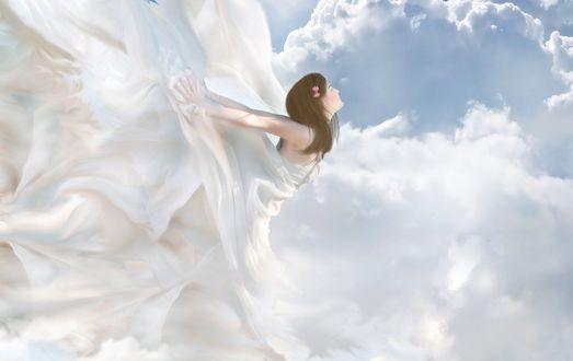 Обои Девушка ангелочек парит в небе на фоне облаков