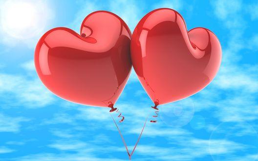 Обои Два красных воздушных шарика в виде сердец на фоне голубого неба
