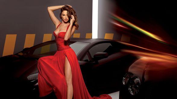 Обои Ирина Шейк в красном платье позирует рядом с машиной
