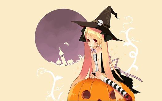 Обои Блондинка-ведьмочка сидит на тыкве